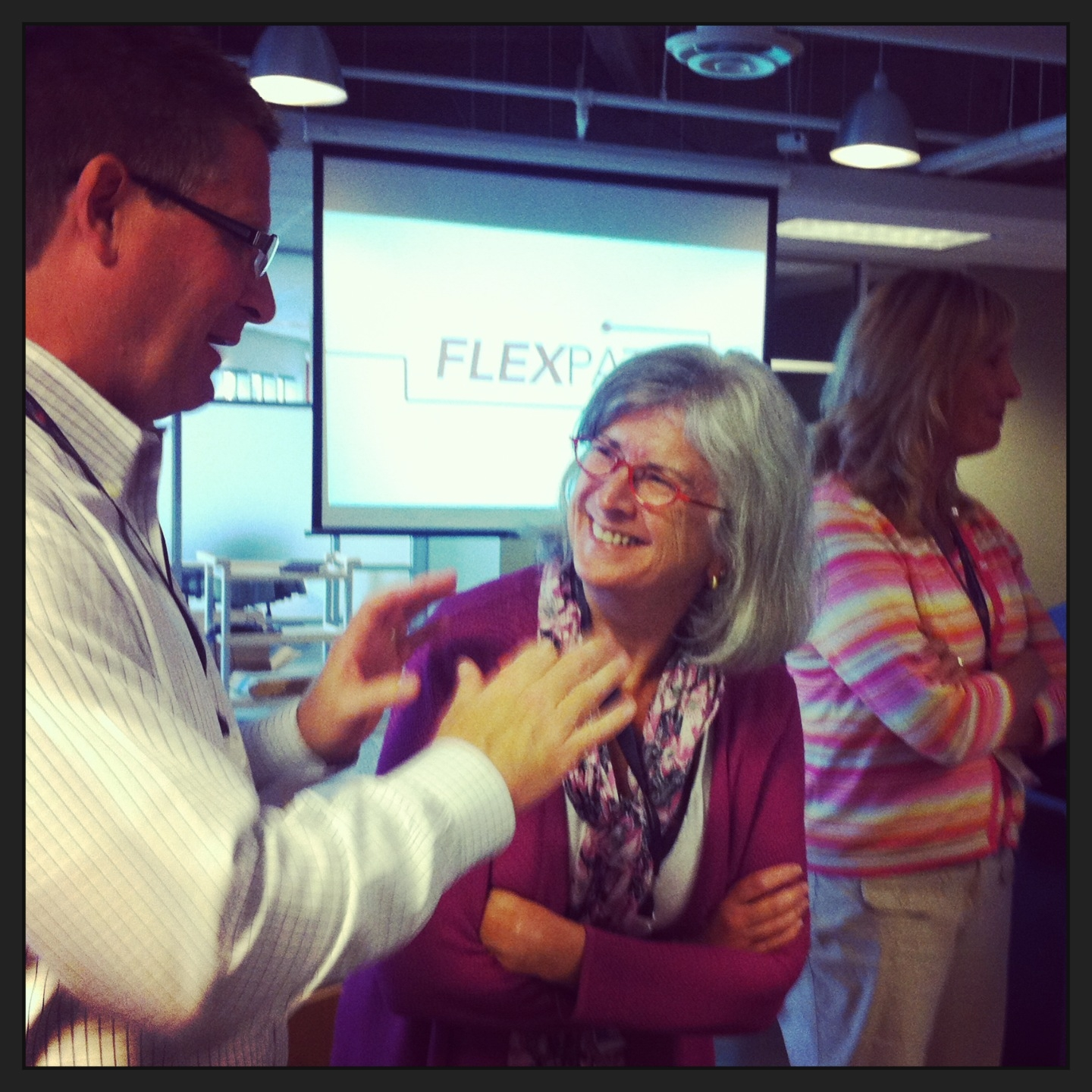 Capella's General Counsel Greg Thom and Chief Academic Officer Deb Bushway chatting at the FlexPath employee celebration.