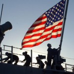 U.S. flag and soldiers
