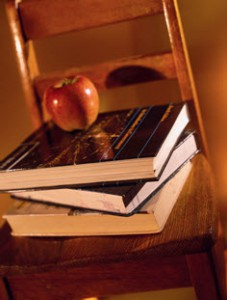 Image of textbooks on a chair