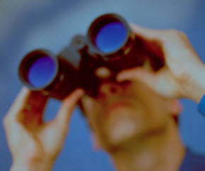 Image of man with binoculars