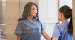 Two nurses having  conversation