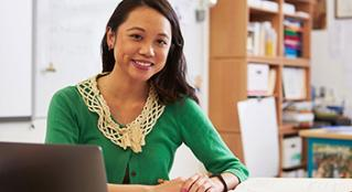 Smiling woman in office setting.