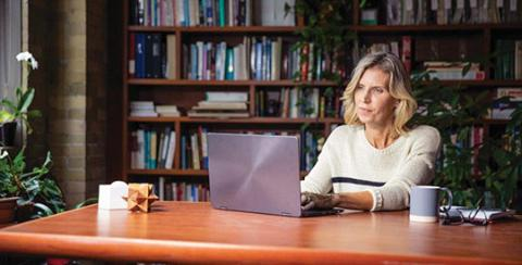 woman at desk on laptop