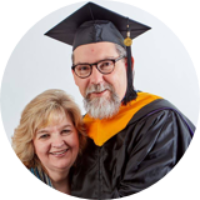 Stephen King, Master of Science in Industrial Organizational Psychology, wearing graduation attire and smiling