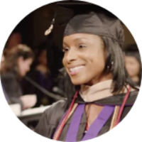 Tarishia Martin, BS Business student, in graduation attire