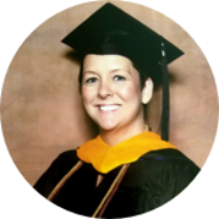 Vickie Bradley, MS in Psychology, Applied Behavior Analysis in graduation attire